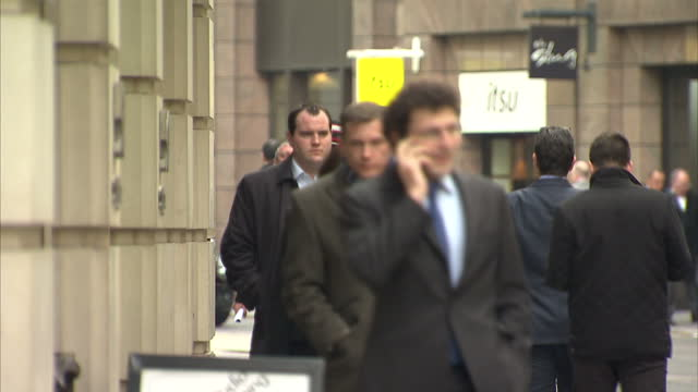 exterior shots of the city of london including the swiss re building and commuters walking city of london streetscenes on april 08, 2013 in london,... - ボブ・マーリー点の映像素材/bロール