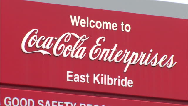 exterior shots of the cocacola enterprises bottling plant in east kilbride showing shots of coca cola branding on signs at the entrance of the plant... - bottling plant stock videos & royalty-free footage