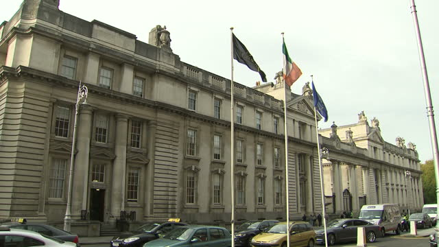 exterior shots of the department of the taoiseach with irish and eu flags flying on 1 december 2017 in dublin ireland - government building stock videos & royalty-free footage