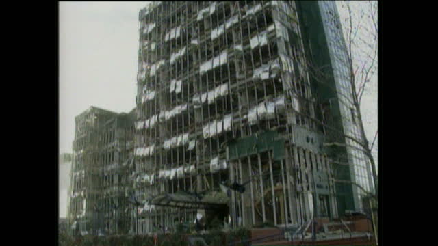exterior shots of the destruction caused by an ira bomb explosion in a building in the docklands area, on february 10, 1996 in london, england. - bomb stock videos & royalty-free footage