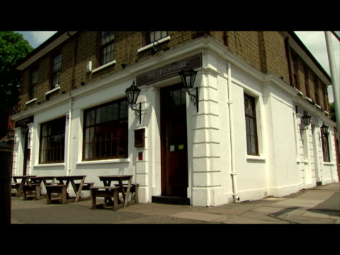 exterior shots of the devonshire pub/restaurant owned by gordon ramsay including shots of the signage gordon ramsay's devonshire pub in chiswick on... - gordon ramsay stock videos and b-roll footage