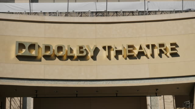 exterior shots of the dolby theatre and tourists and superhero character walking along hollywood boulevard on 13 july 2018 in los angeles, united... - the dolby theatre stock videos & royalty-free footage