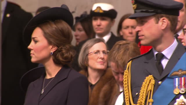 Exterior shots of the Duke and Duchess of Cambridge and Prince Harry standing together watching a military parade pass St Paul's Cathedral>> on March...