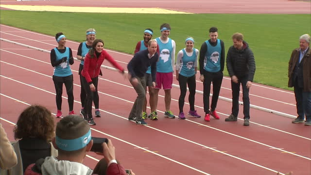 Exterior shots of the Duke and Duchess of Cambridge and Prince Harry taking part in a relay race during a training day for Team Heads Together...