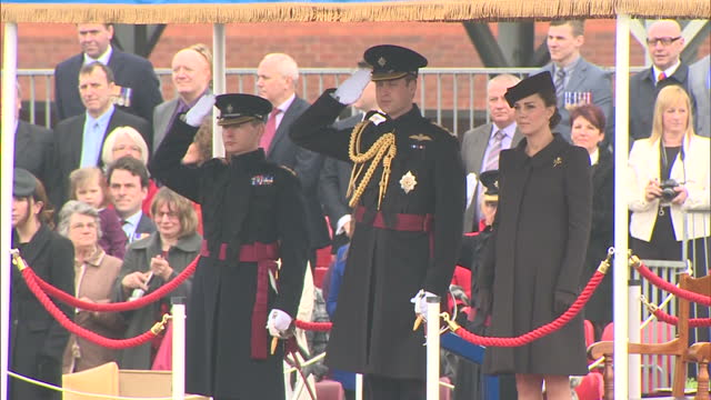 vidéos et rushes de exterior shots of the duke and duchess of cambridge arriving at mons barracks and standing as 'god save the queen' in played>> on march 17 2015 in... - mons barracks