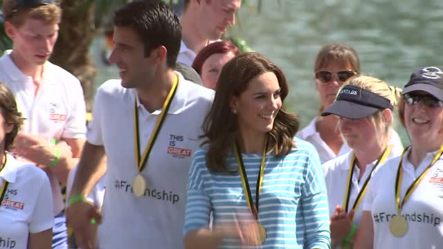 exterior shots of the duke and duchess of cambridge being congratulated alongside rowers from cambridge and heidelberg after taking part in a race on... - ハイデルベルク点の映像素材/bロール