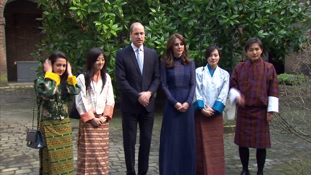 Exterior shots of the Duke and Duchess of Cambridge meeting with a group of young people from Bhutan all dressed in Bhutanese traditional clothes>>...