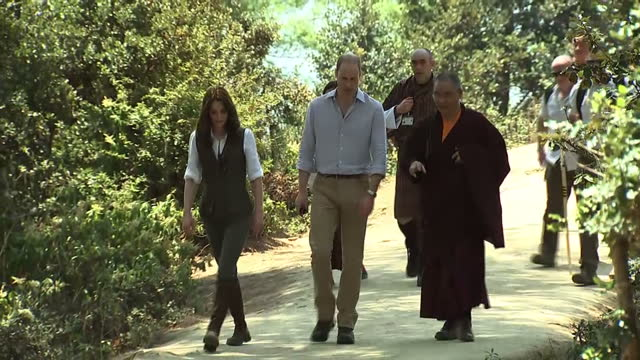 Exterior shots of the Duke and Duchess of Cambridge on a visit to the Taktsang Monastery spinning prayer wheels on April 15 2016 in Thimphu Bhutan