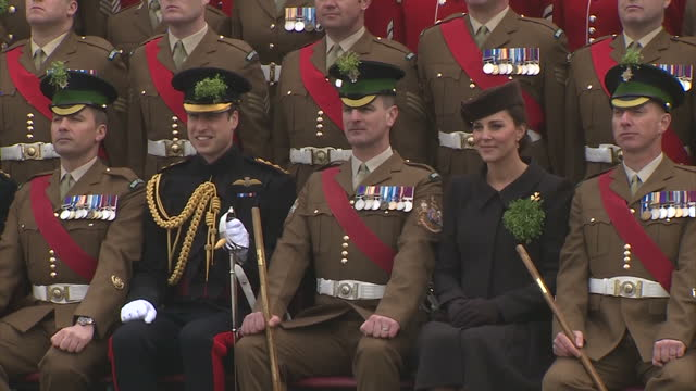 exterior shots of the duke and duchess of cambridge smiling as they pose for a group photograph with members of the 1st battalion irish guards during... - aldershot stock videos & royalty-free footage