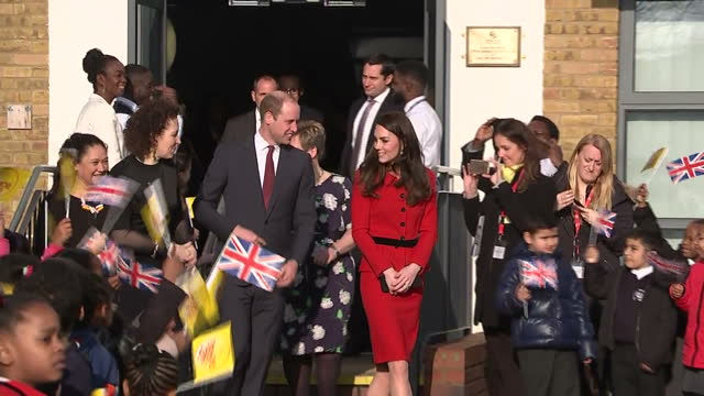 Exterior shots of the Duke and Duchess of Cambridge speaking speaking to members of staff after visiting Mitchell Brook Primary School as pupils...