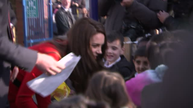 Exterior shots of the Duke and Duchess of Cambridge speaking speaking to local schoolchildren after visiting Mitchell Brook Primary School for the...