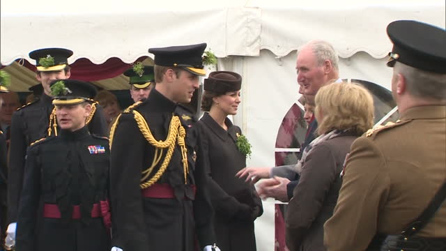 exterior shots of the duke and duchess of cambridge speaking to officials and members of the 1st battalion irish guards before departing after taking... - aldershot stock videos & royalty-free footage