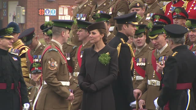 exterior shots of the duke and duchess of cambridge speaking to officers of the 1st battalion irish guards during st patrick's day celebrations at... - aldershot stock videos & royalty-free footage