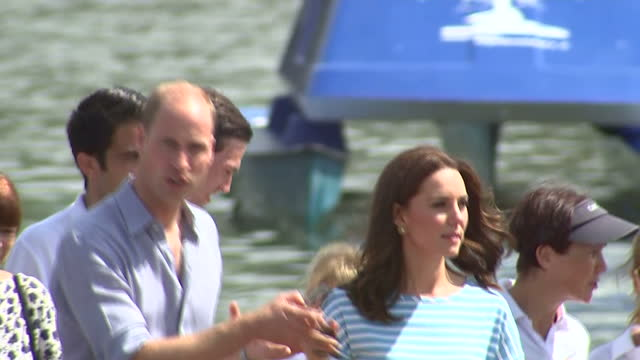 Exterior shots of the Duke and Duchess of Cambridge speaking with rowers and officials after taking part in a boat race on the River Neckar during...
