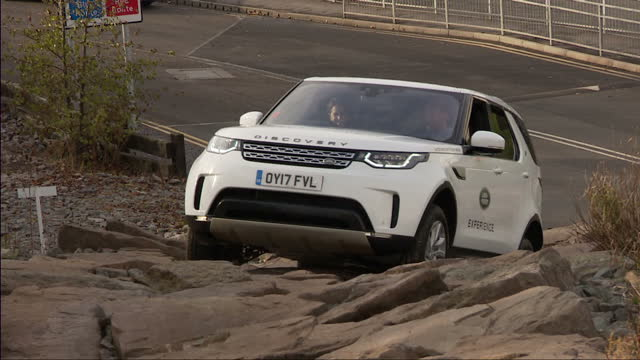 Exterior shots of the Duke and Duchess of Cambridge test driving two Land Rover Discovery cars at the Jaguar Land Rover Experience centre with Prince...