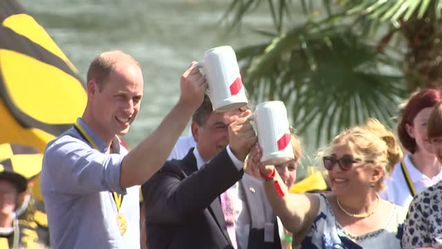 Exterior shots of the Duke and Duchess of Cambridge toasting with steins of beers and speaking to officials after taking part part in a race on the...