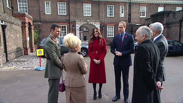 exterior shots of the duke and duchess of cambridge walking out of the gates of kensington palace and meeting with royal british legion supporters... - kensington palace video stock e b–roll