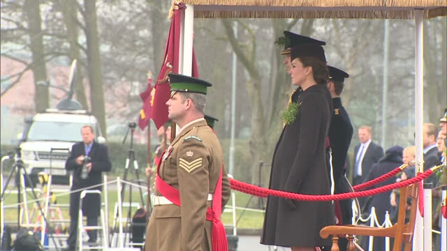 exterior shots of the duke and duchess of cambridge watching the st patrick's day parade of the 1st battalion irish guards at mons barracks, preceded... - aldershot stock videos & royalty-free footage