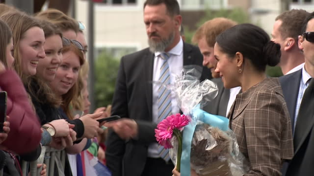 exterior shots of the duke and duchess of sussex greeting and being greeted by the public and meghan being given flowers by the public on 28 october... - new zealand stock videos & royalty-free footage
