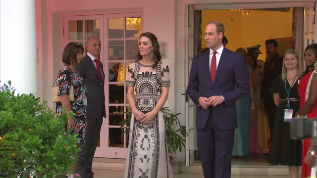 Exterior shots of the Duke Duchess of Cambridge Prince William Catherine arriving at a garden party in honor of the Queen's upcoming 90th birthday on...