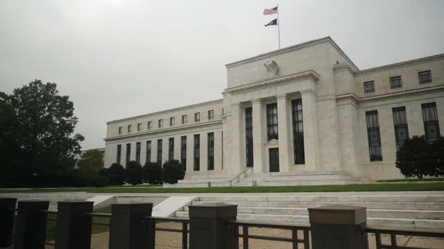 Exterior shots of the Eccles building home of the US Federal Reserve with a Stars and Stripes flag flying and a fountain outside on November 01 2016...