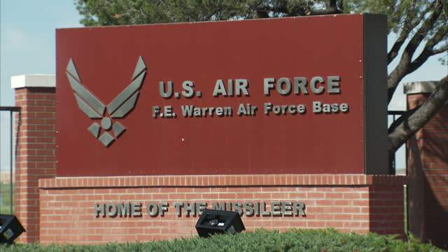 exterior shots of the entrance and sign for fe warren air force base, 'home of the missileer', where minuteman nuclear missiles are stored in... - nuclear missile launch stock videos & royalty-free footage