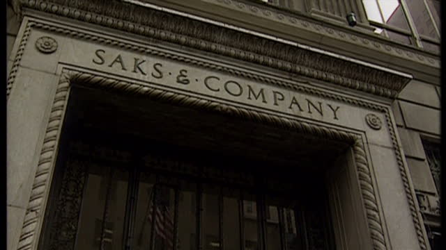 Exterior shots of the entrance to Saks a wide shots of the building and window displays of womenswear from British designers at Saks Fifth Avenue on...