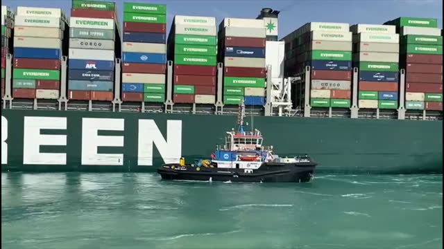 exterior shots of the ever given container ship, owned by evergreen marine, being pulled by tug boats after being stranded and blocking the suez... - suez canal stock videos & royalty-free footage