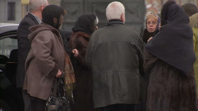 Exterior shots of the family of Andrey Karlov arriving at funeral including his wife Marina Karlova on December 22 2016 in Moscow Russia