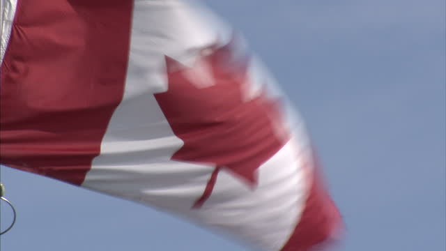 exterior shots of the flag of canada aka the maple leaf blowing in the wind on august 25 2007 in cambridge bay canada - inuit stock videos & royalty-free footage