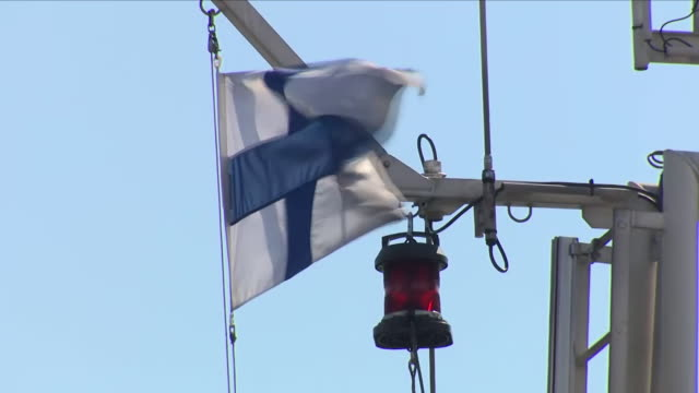 Exterior shots of the flag of Finland blowing on top of a ferry full of tourists on July 17 2018 in Helsinki Finland