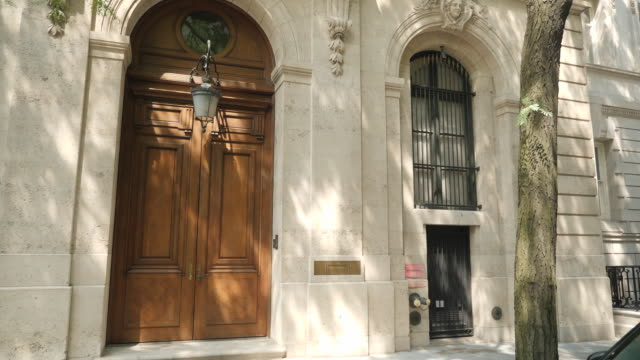 exterior shots of the former new york mansion of jeffrey epstein on the upper east side of manhattan with cctv camera and intercom by door on 14 july... - ghislaine maxwell stock videos & royalty-free footage