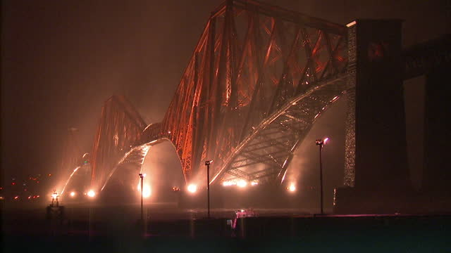 exterior shots of the forth road bridge lit up at night during high winds and rain with traffic warning signs on the approach to the bridge high... - gale stock videos and b-roll footage