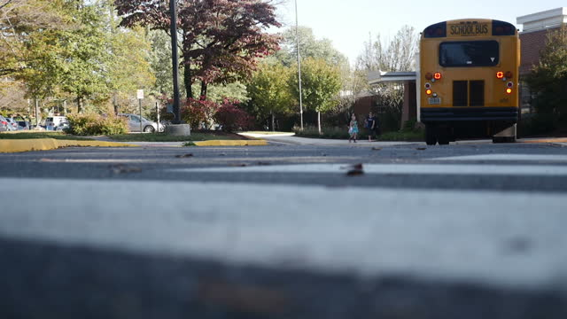Exterior shots of the Franklin Sherman Elementary School with yellow school buses outside as parents walk their kids to school on October 09 2015 in...