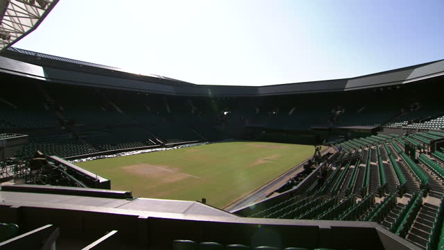 exterior shots of the fred perry statue at the all england club and inside centre court on a sunny day, roof open. fred perry statue and centre court... - roof stock videos & royalty-free footage