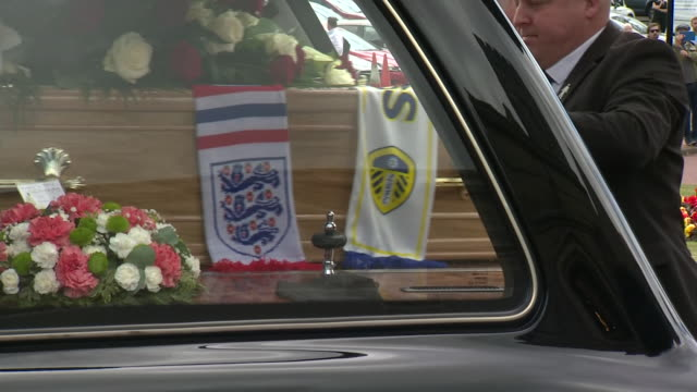 exterior shots of the funeral cortege of the late england footballer jack charlton arriving in cortege at church and mourners walking into church on... - jack charlton stock videos & royalty-free footage