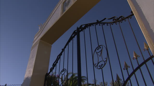 Exterior shots of the gates to Cliff Richard's wine estate Quinta do Moinho and two mounted police trotting past on horseback on August 16 2014 in...