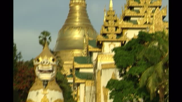 exterior shots of the golden temple and statues of gold white lions and the city hall on october 3 2003 in pathein myanmar - imperial lion stock videos and b-roll footage