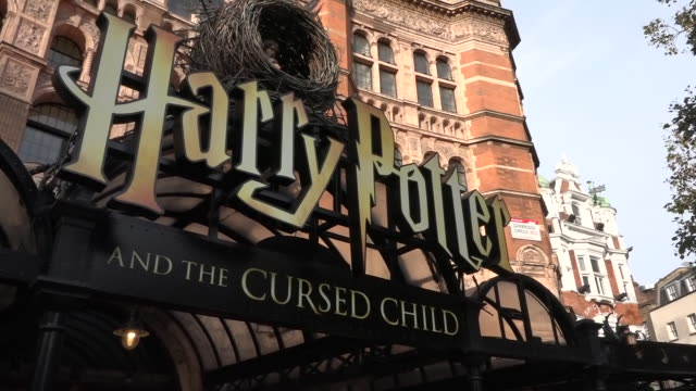 stockvideo's en b-roll-footage met exterior shots of the harry potter and the cursed child artwork outside the palace theatre, posters for the theatre show and covid-19 notice at the... - clean