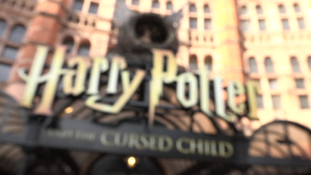 stockvideo's en b-roll-footage met exterior shots of the harry potter and the cursed child artwork outside the palace theatre and posters for the theatre show on the 30th september... - clean