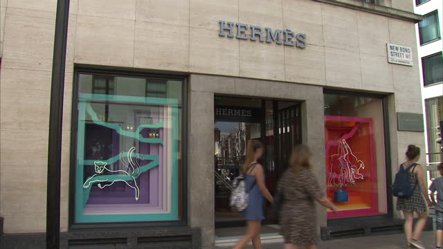 exterior shots of the hermes fashion shop and a new bond street road sign on august 17 2016 in london england - hermes designer label stock videos and b-roll footage