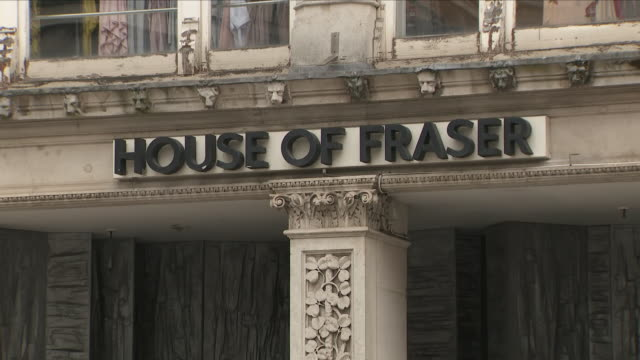 exterior shots of the house of fraser department store with people walking past including close up shots of the welsh flag on 7th june 2018 in... - ウェールズ文化点の映像素材/bロール