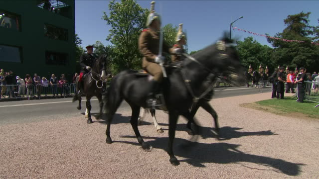 Exterior shots of The Household Cavalry riding for the Royal wedding procession approaching and going along The Long Walk during the wedding route...