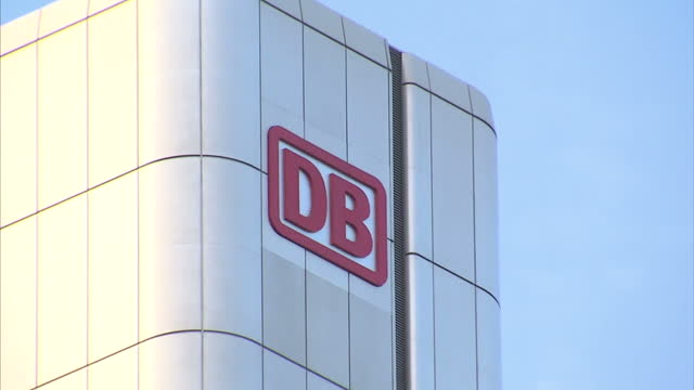 exterior shots of the iron bridge eiserner steg dresdner bank logo on headquarters building ubs building euro sign light sculpture and eurotower... - dresdner bank stock videos and b-roll footage