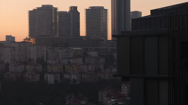 vídeos de stock, filmes e b-roll de exterior shots of the istanbul skyline at sunset, including shots of skyscrapers and traffic on a major road and on a bridge crossing the bosphorus... - major road