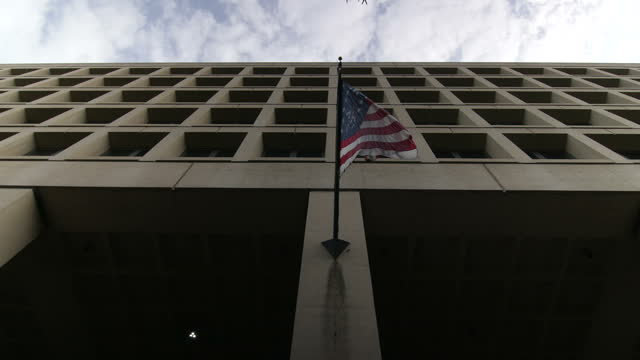 exterior shots of the j. edgar hoover building, headquarters of the federal bureau of investigation on may 10 in washington, dc. - fbi stock videos & royalty-free footage