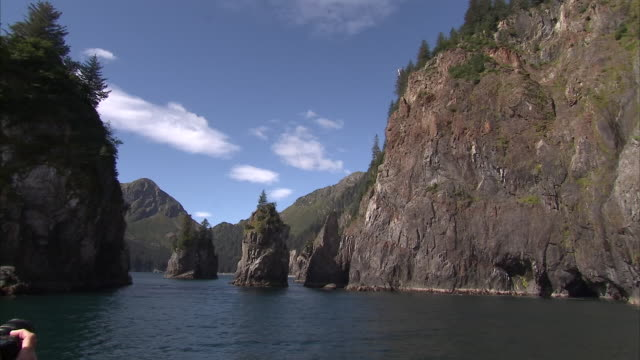 exterior shots of the kenai fjords on the kenai peninsula from aboard a boat on a sunny day on 15th september 2015 in alaska, united states. - kenai peninsula stock videos & royalty-free footage