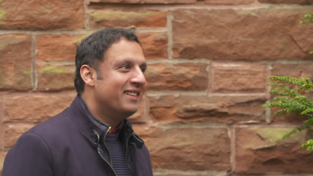 exterior shots of the leader of the scottish labour party, anas sarwar and his wife furheen ashrif, arriving to cast their votes in the scottish... - scottish culture stock videos & royalty-free footage
