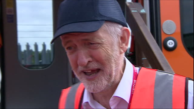 exterior shots of the leader of the uk labour party jerermy corbyn being invited to test drives bombardier train ahead of its roll out on barking to... - 試運転点の映像素材/bロール