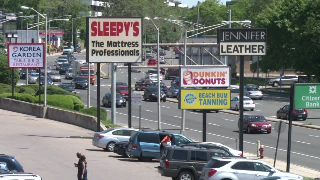 vídeos de stock e filmes b-roll de exterior shots of the line up of store signs on central park ave in yonkers ny / ws and cus of signs showing shopping plaza and central park ave... - citizens bank park
